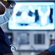 Doctor using medical equipment