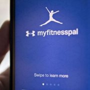 Person holding smart phone with myfitnesspal app open