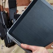 Military person holding tablet