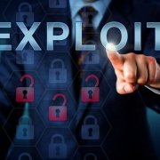 Businessman pointing to word Exploit on screen