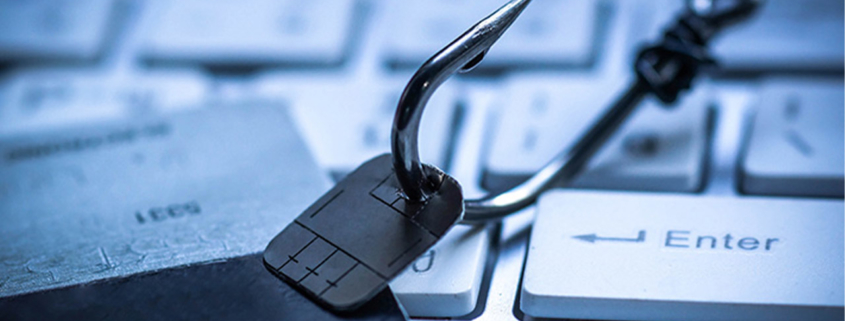 Spear-Phishing Fish Hook with Computer Chip on Keyboard