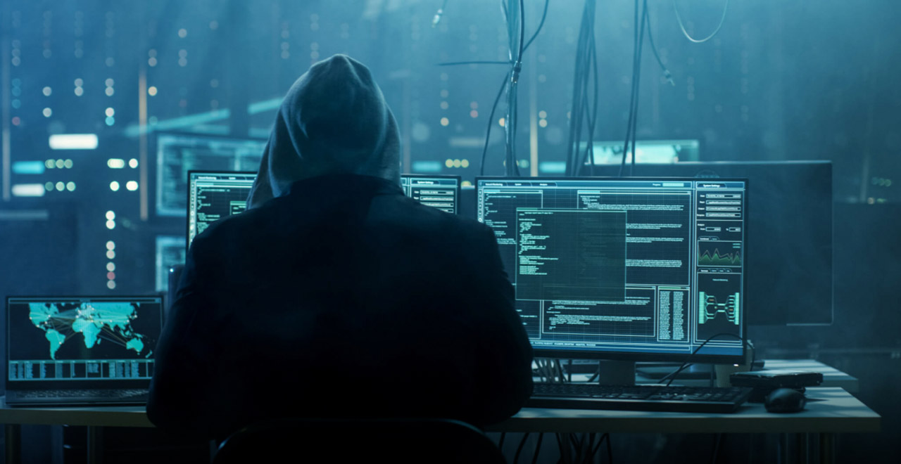 Hacker-in-hoodie-in-dark-room securing WFX